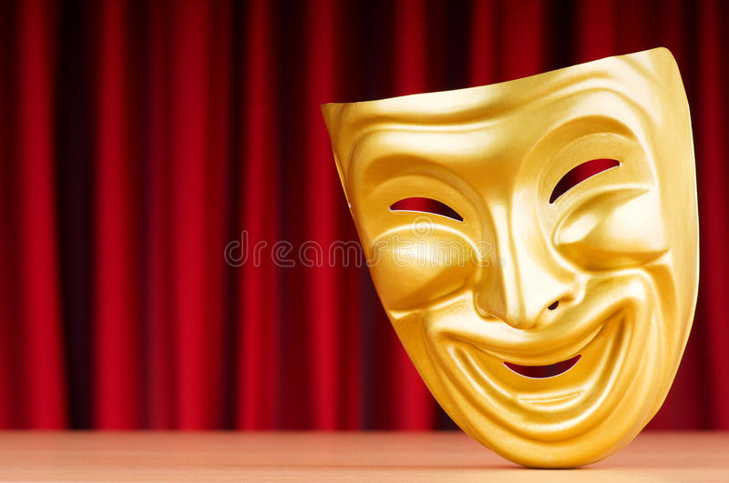 Theatre mask on the background stock photos
