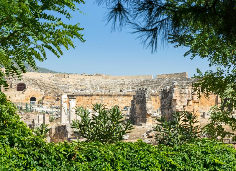 The Theatre was probably constructed under the reign of Hadrian. View of the ruins of the city of Hierapolis, modern name of the location - Pamukkale, Turkey royalty free stock photo