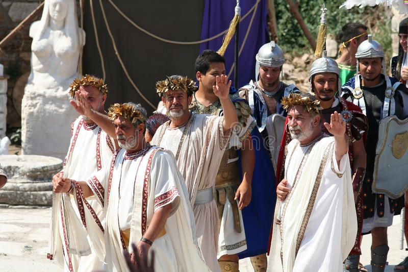 Theatrical performance in Ephesus, Turkey. Actors dressed in ancient costumes in a historic performance in Ephesus, Turkey. Ephesus was an ancient Greek city royalty free stock photos