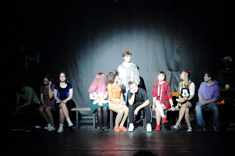 Theatrical performance of teenagers with a spotlight. Theatrical performance of adolescents with the center of attention. Variety and Drama Theater Mandarin royalty free stock photos