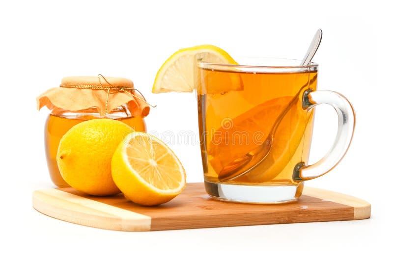 Thee met citroen en honing stock afbeelding