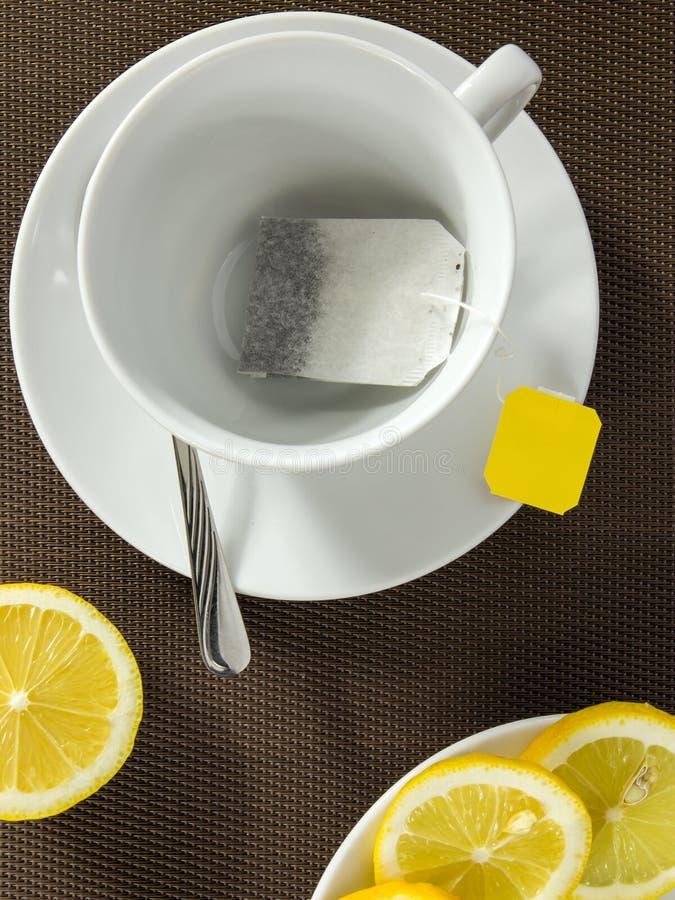 Theekop en plakken van citroen royalty-vrije stock afbeelding