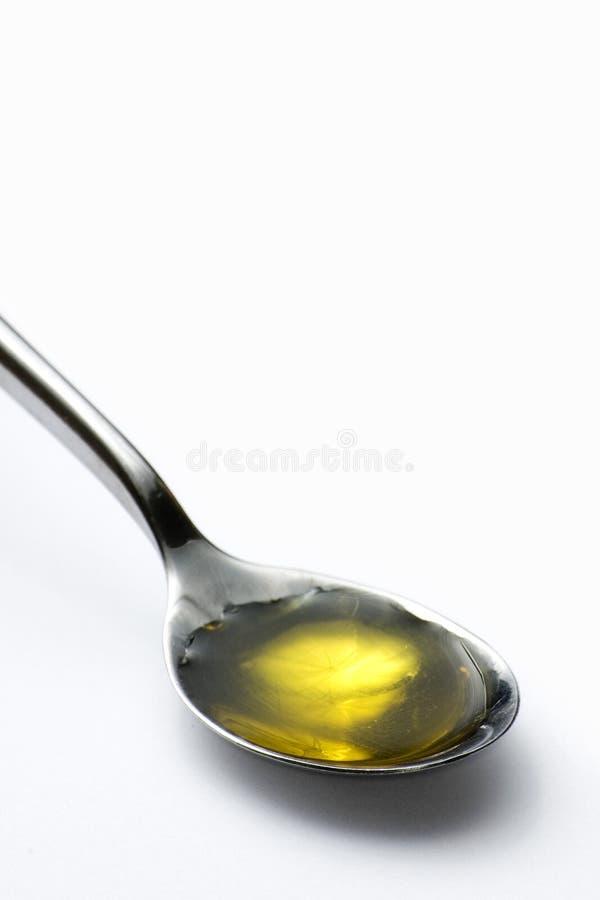 Theelepeltje van olijfolie stock foto's