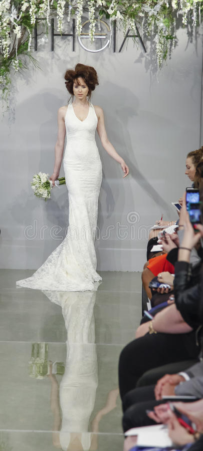 The Theia Spring 2016 Bridal Collection. New York, NY, USA - April 16, 2015: A model walks runway for Theia Spring 2016 Bridal Collection at Theia Showroom stock image
