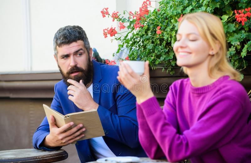 Their first meeting in cafe. First meet of girl and mature man. Couple in love on romantic date. Morning coffee. Brutal royalty free stock images