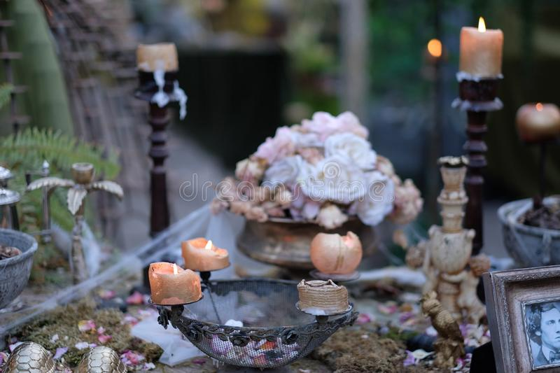 Thematic decoration with vintage items and burning candles. In the pavilion royalty free stock image