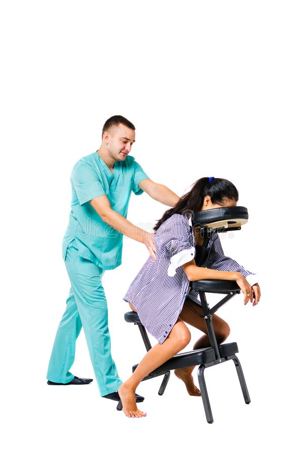 Theme massage and office. Male therapist with blue suit doing back and neck massage for young woman worker, business woman in shir. Theme massage and office stock image