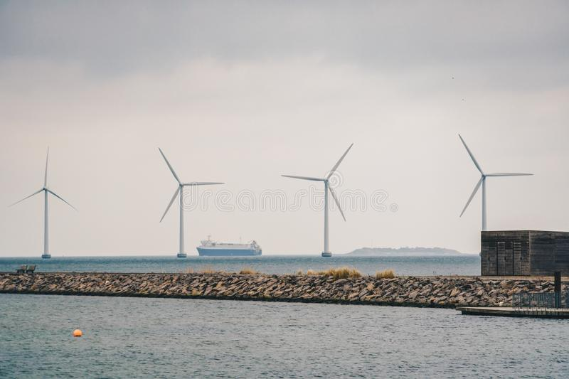 The theme is net power generation and environmental protection. A number of wind blades, wind power in the Baltic Sea in. Europe Denmark Copenhagen in winter royalty free stock image
