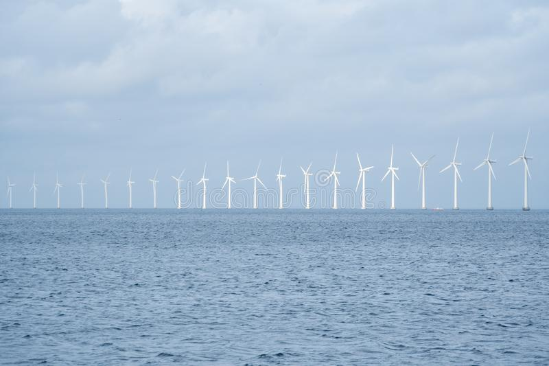 The theme is net power generation and environmental protection. A number of wind blades, wind power in the Baltic Sea in. Europe Denmark Copenhagen in winter stock images