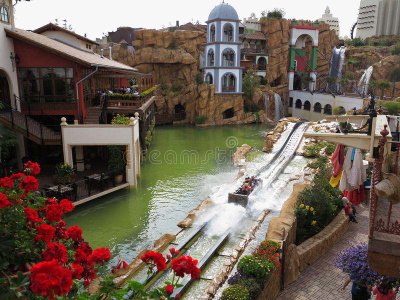 Log flume ride family fun in Mexican scenery stock images