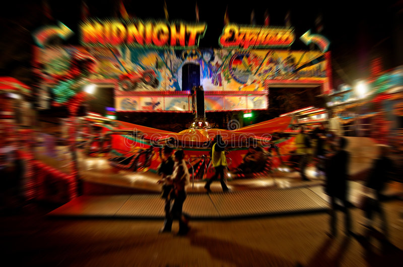 Theme Park Ride Blurred. Image of a theme park ride blurred to show speed stock photos
