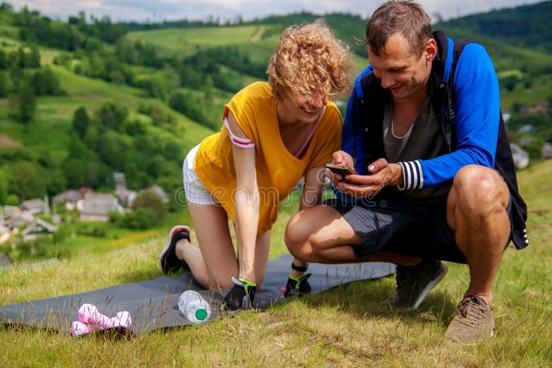 Young athlete couple relaxing in the park. stock image
