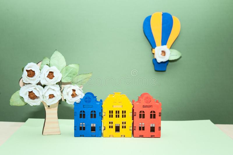 Theme spring , eco-friendly  city, toy houses, a balloon with flowers and a blossoming stock images