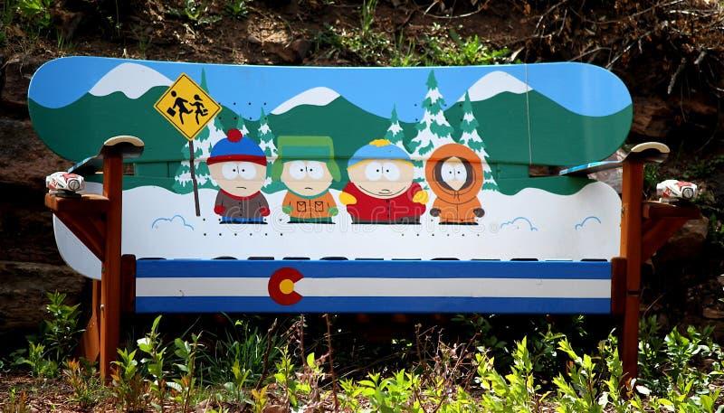Themed bänk för South Park tecknad film som göras av snöbräden arkivbilder