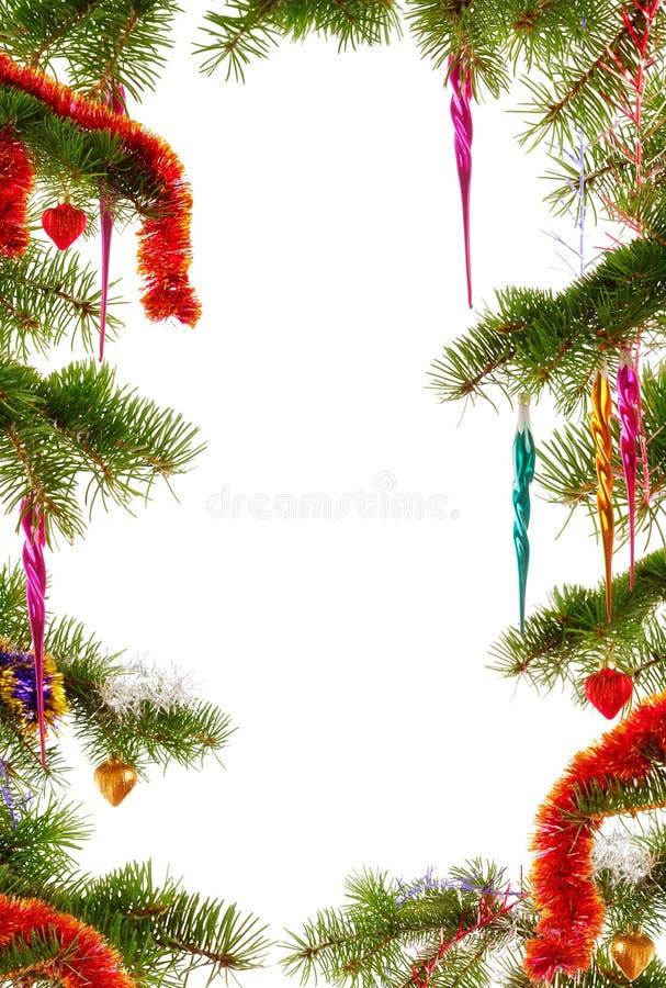 Themed bakgrund för jul med granfilialer och prydnader royaltyfri bild