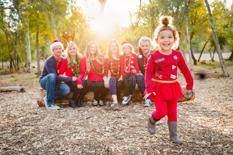 Themed multietnisk familjstående för jul utomhus arkivbild
