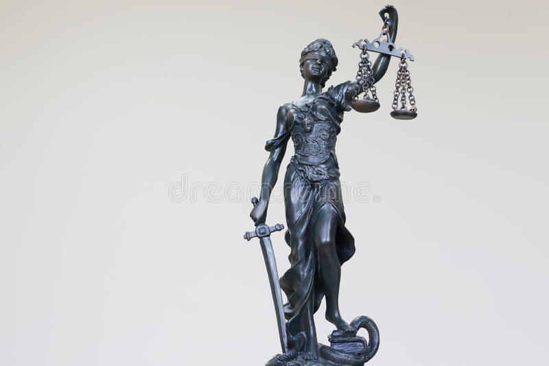 Themis. In the Lawyer Office and coins are in the scales, shallow depth of field royalty free stock images