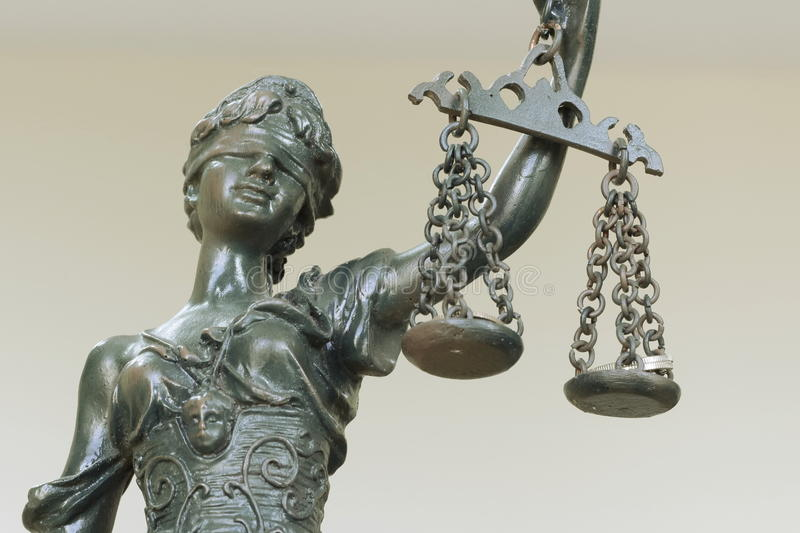 Themis. In the Lawyer Office and coins are in the scales, shallow depth of field royalty free stock photos