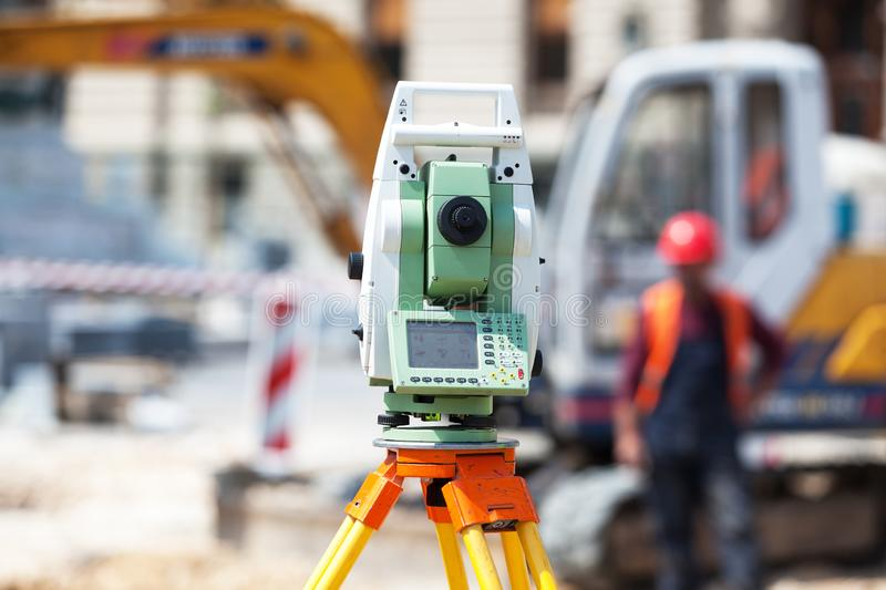 Theodolite or surveyor equipment tacheometer outdoors at construction site royalty free stock photo