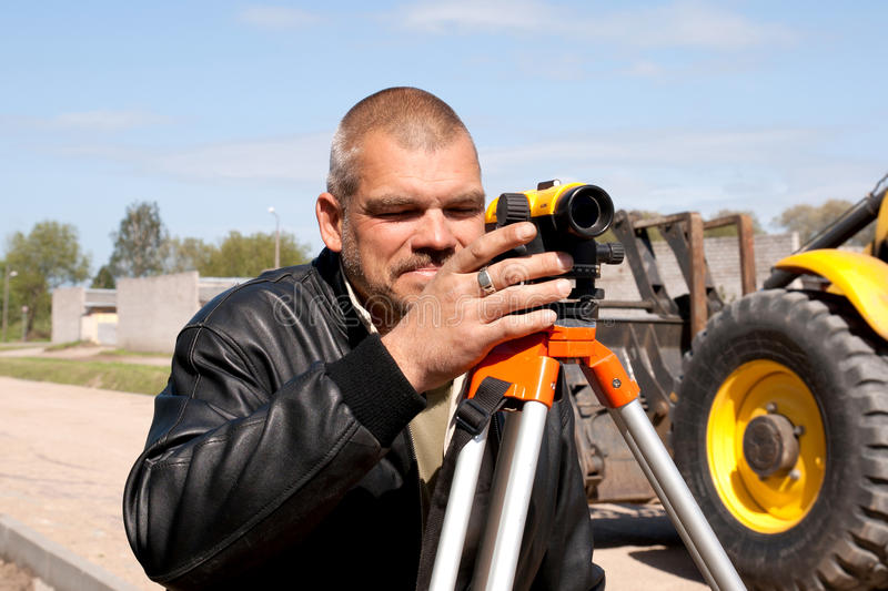 Download Theodolite On A Tripod With Construction Worker Stock Photo - Image: 20572298