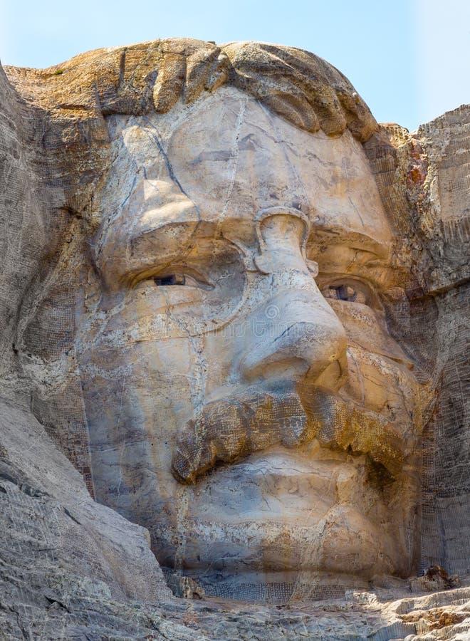 Theodore Roosevelt dat op Onderstel Rushmore wordt gesneden stock fotografie