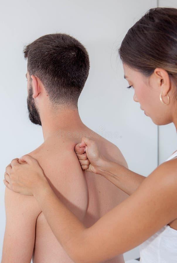 Therapeutic back massage stock photography