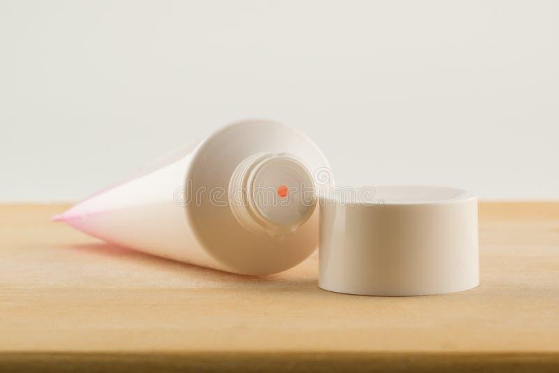 Therapeutic cream in a container stock image
