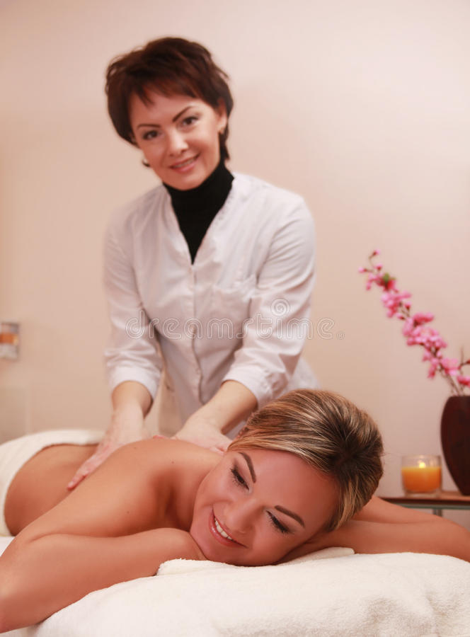 Therapist. Making massage in spa salon stock photo