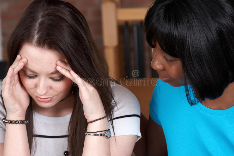 A therapist comforting her client royalty free stock photo