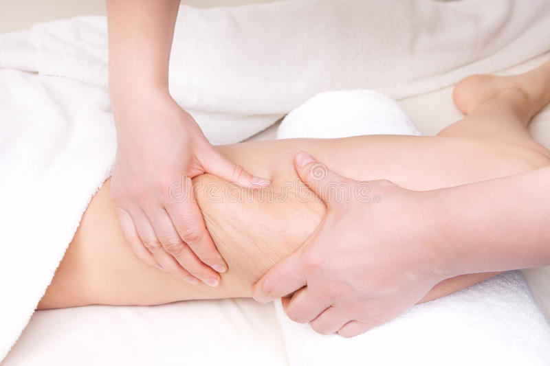 Therapist doing anti cellulite massage royalty free stock photography