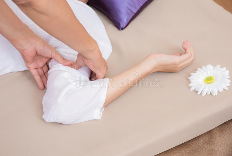 Therapist doing a pressure point massage of deltoids muscle. royalty free stock photo