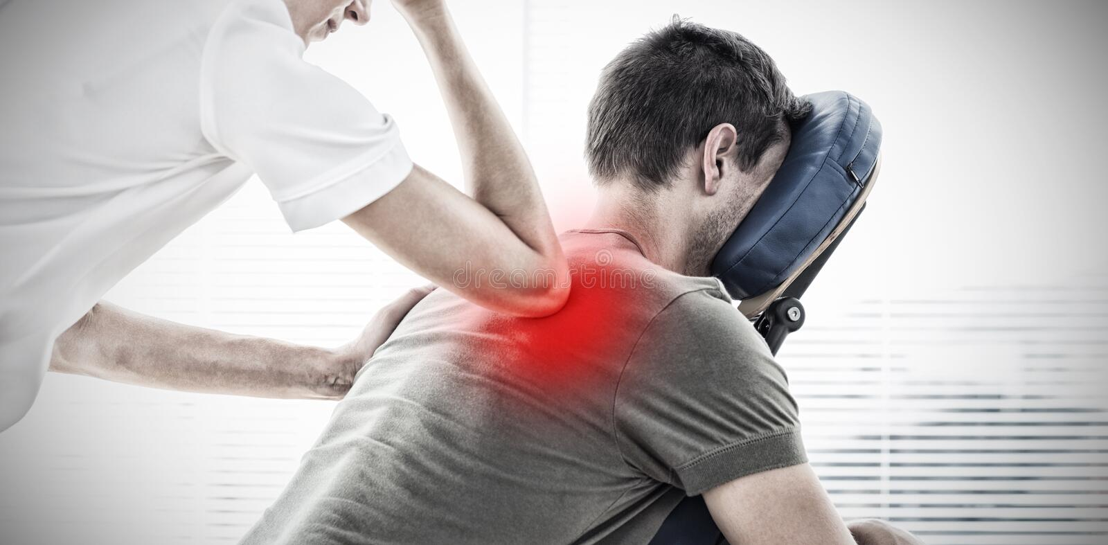Composite image of therapist giving back massage to man royalty free stock photo