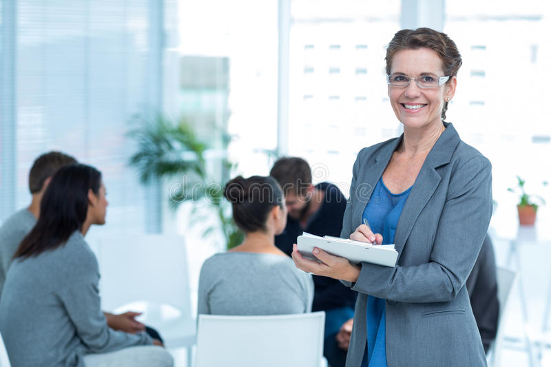 Therapist with group therapy in session stock images