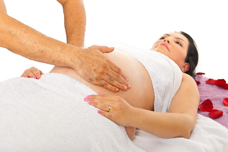 Therapist massaging pregnant belly stock photos