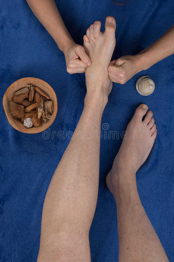 Therapist in reflexology foot massage, spa foot treatment, stock photography
