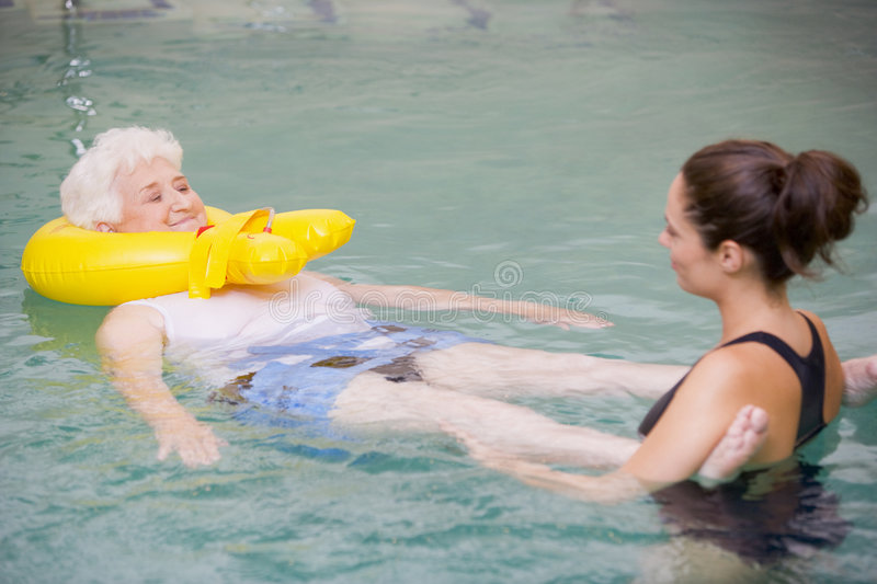 Therapist And Senior Patient In Hydro Pool stock photo