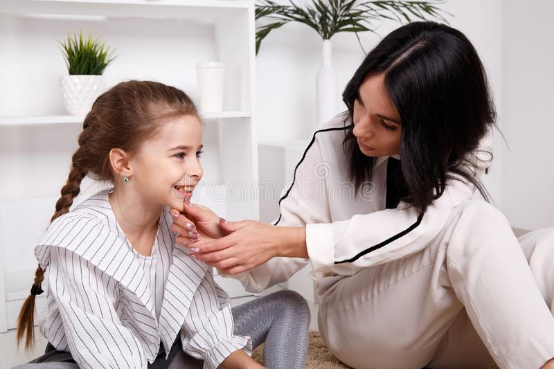 Therapist session concept. Female psychologist working with cute little child. royalty free stock images
