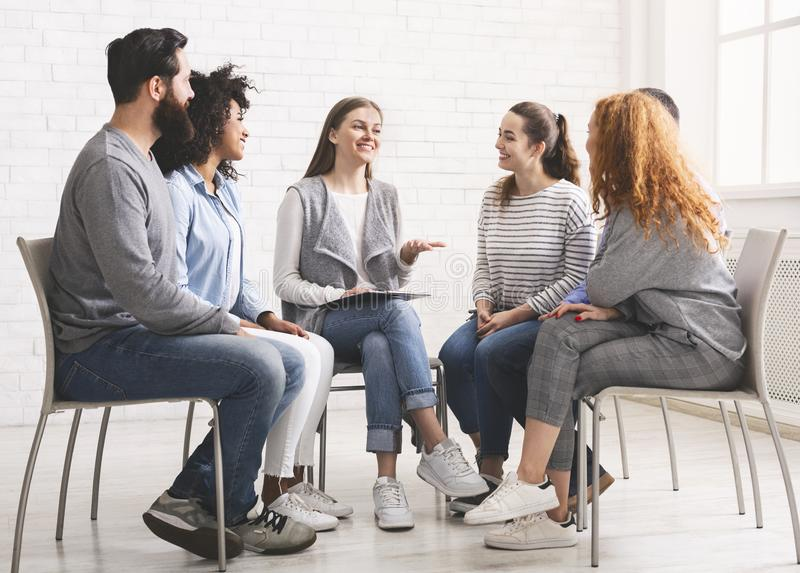 Therapist speaking to rehab group at therapy session royalty free stock photography