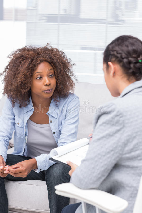 Therapist taking notes stock photography