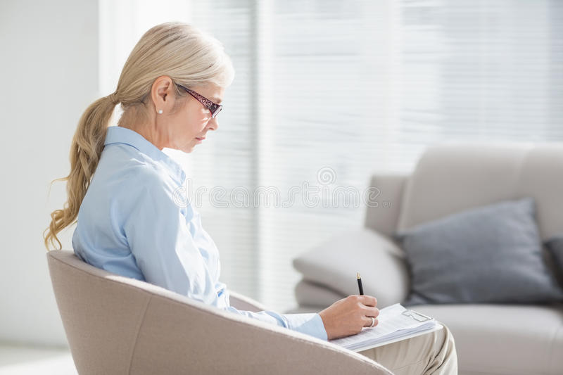 Therapist writing notes stock images