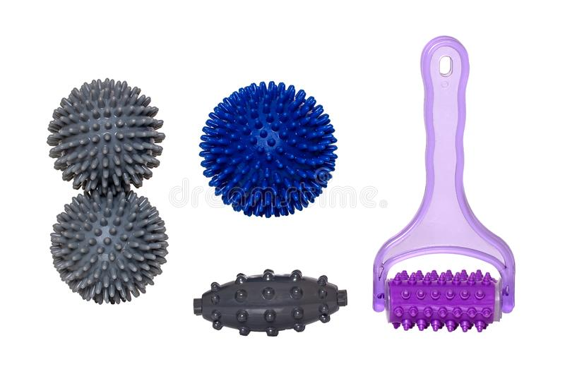 Therapy and fitness equipment. Closeup of spiky massage balls and rollers for health therapy isolated on a white background.  royalty free stock photo