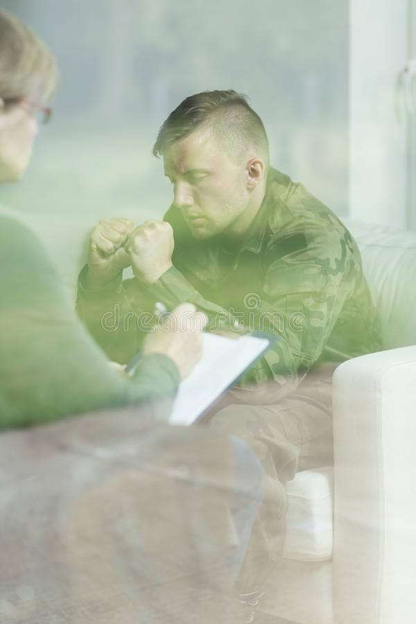 Therapy of psychical trauma. Despair soldier during therapy of psychical trauma royalty free stock photos