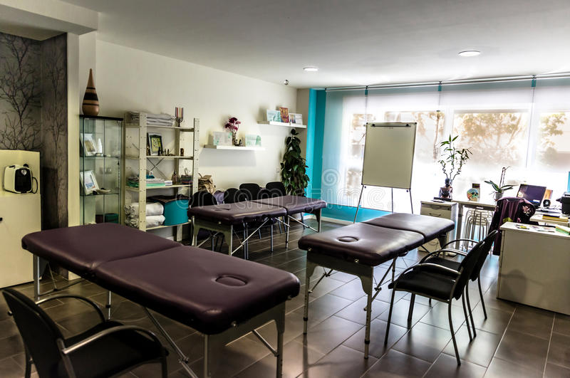 Therapy teaching center, with stretchers and chairs royalty free stock photo