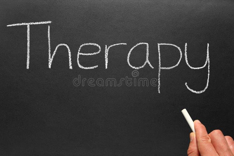 Therapy, written on a blackboard.