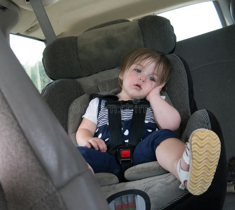 Are we there yet?. Child in car seat. Bored and surely wondering, Are we there yet royalty free stock photos