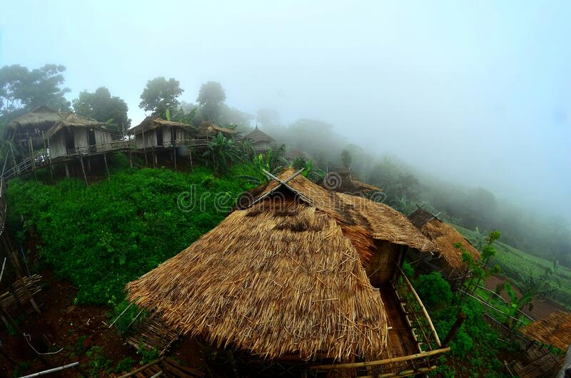 There are Akha homestays located on a hillside covered and foggy background at Doi Sa Ngo ,Chiang Rai , Thailand stock images
