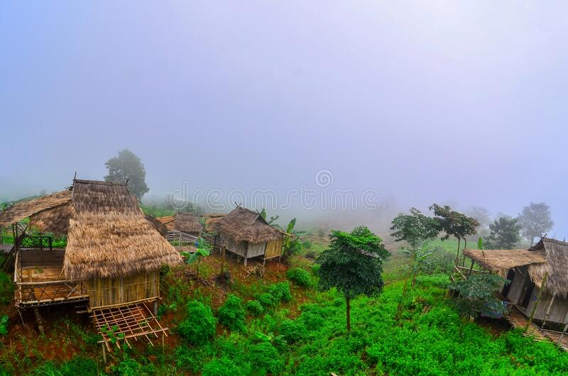 There are Akha homestays located on a hillside covered and foggy background at Doi Sa Ngo ,Chiang Rai , Thailand stock photography