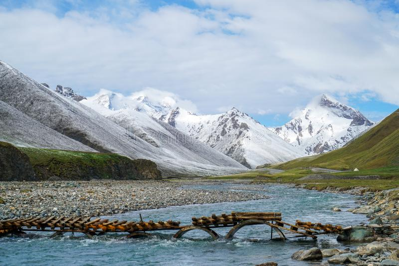 Snow Mountain, blue sky, clean river.The scenery along the DuKu highway. stock photos
