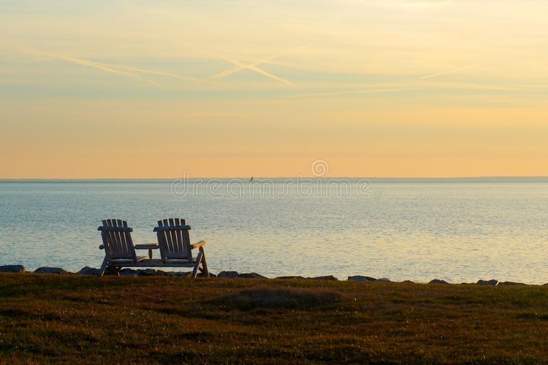The bench facing the sea stock photography