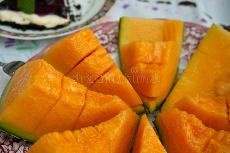 There are Cantaloupe melon slices are on the table. royalty free stock photography